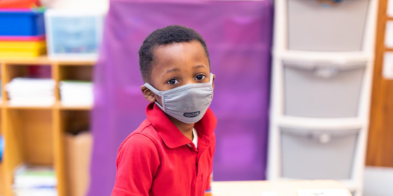 Masked elementary student.