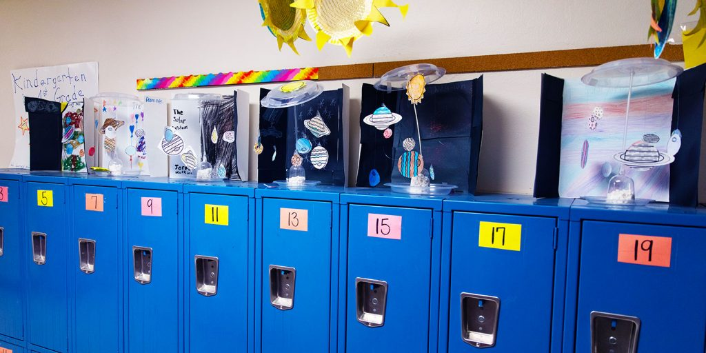 blue lockers and solar system hallway projects displayed.